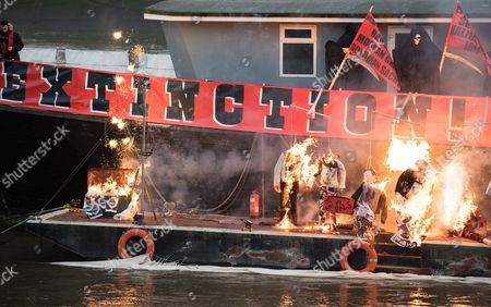 Stock Image of An Estimated Five Million Worth Punk Music Memorabilia is on Fire on a Barge on the River Thames in Chelsea Central London Britain 26 November 2016 Joe Corre and His Mother Vivienne Westwood Burn the Rare Memorabilia Include Rare Sex Pistol's Recordings a Doll in a Figure of Sid Vicious Embossed with a Swastika Clothing Belonging to Johnny Rotten and Vivienne Westwood in Protest Against Punk Rock Now Being Owned by the Corporate Sector Joe Corre and His Mother Burned the Rare Memorabilia Which Include; Rare Sex Pistol's Recordings a Doll in a Figure of Sid Vicious Embossed with a Swastika and Clothing Belonging to Johnny Rotten the Two Stated That the Items Were Set Alight to Make a Statement Against Punk Rock Now Being Owned by the Corporate Sector Epa/hayoung Jeon United Kingdom London