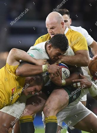 England's Nathan Hughes (c) is Tackled by Australia's Stephen Moore (r) During the Rugby Union International Match Between England and Australia at Twickenham Stadium in London Britain 03 December 2016 United Kingdom London