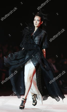 Stock Photo of A Model Presents a Creation From the to Heart Series by Chinese Designers Qi Gang and Chen Kun During the Mercedes-benz China Fashion Week in Beijing China 28 October 2016 the Fashion Week Runs From 25 October to 02 November China Beijing