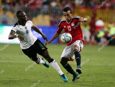 Stock Image of Mohamed Abdel Shafy of Egypt (r) in Action Against Emmanuel Agyemang of Ghana During the 2018 Fifa World Cup Qualifying Soccer Match Between Egypt and Ghana at Borg Al Arab Stadium in Alexandria Egypt 13 November 2016 Egypt Alexandria