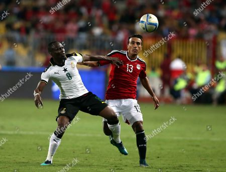 Mohamed Abdel Shafy of Egypt (r) in Action Against Emmanuel Agyemang of Ghana During the 2018 Fifa World Cup Qualifying Soccer Match Between Egypt and Ghana at Borg Al Arab Stadium in Alexandria Egypt 13 November 2016 Egypt Alexandria