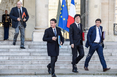 French Prime Minister Manuel Valls (c) is Flanked by French Minister For State Reform Jean-vincent Place (2-r) and Sports Minister Patrick Kanner (r) After the Weekly Cabinet Meeting at the Elysee Palace in Paris France 30 November 2016 Others Are not Identified France Paris