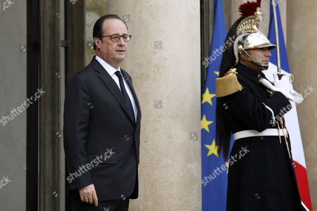 Stock Picture of French President Francois Hollande (l) Waits Outside the Elysee Palace to Welcome Ivory Coast President Alassane Dramane Ouattara (not Pictured) in Paris France 22 November 2016 France Paris