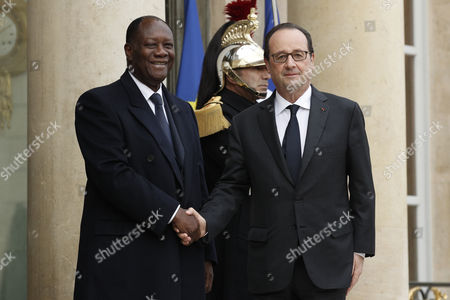 French President Francois Hollande (r) Greets Ivory Coast President Alassane Dramane Ouattara (l) Upon His Arrival at the Elysee Palace in Paris France 22 November 2016 France Paris