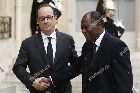 Stock Image of French President Francois Hollande (l) Greets Ivory Coast President Alassane Dramane Ouattara (r) Upon His Arrival at the Elysee Palace in Paris France 22 November 2016 France Paris