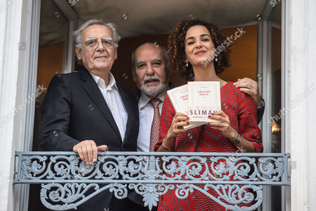 French Author Leila Slimani (r) Flanked by President of the Jury Bernard Pivot (l) and Writer Tahar Ben Jelloun (c) Poses with Her Book at the Drouant Restaurant After Winning the Goncourt Literary Prize 2016 For Her Book 'Chanson Douce' at the Drouant Restaurant in Paris France 03 November 2016 the Prix Goncourt is Given Annually to an Author by the French Literary Organization 'Societe Litteraire Des Goncourt' France Paris