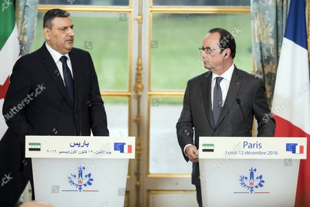 Stock Photo of Syrian Opposition High Comity General Coordinator Riyad Hijab (l) and French President Francois Hollande Hold a Press Conference at the Elysee Palace Following a Meeting in Paris France 12 December 2016 France Paris