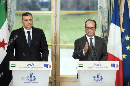 Syrian Opposition High Comity General Coordinator Riyad Hijab (l) and French President Francois Hollande Hold a Press Conference at the Elysee Palace Following a Meeting in Paris France 12 December 2016 France Paris