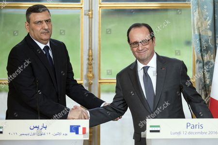 Syrian Opposition High Comity General Coordinator Riyad Hijab (l) and French President Francois Hollande Shakes Hands After They Delivered a Speech at the Elysee Palace Following a Meeting in Paris France 12 December 2016 France Paris