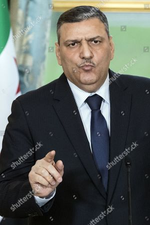Stock Picture of Syrian Opposition High Comity General Coordinator Riyad Hijab and French President Francois Hollande (not Pictured) Hold a Press Conference at the Elysee Palace Following a Meeting in Paris France 12 December 2016 France Paris
