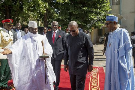 A Photograph Made Available on 14 December 2016 Shows President of Gambia Yahya Jammeh (l) Welcoming President of Nigeria Muhammadu Buhari (r) President of Sierra Leone Ernest Bai Koroma (3-r) and Outgoing President of Ghana John Dramani Mahama (2-r) For Talks at the State House in Banjul Gambia 13 December 2016 the Talks Come in the Wake of Yahya Jammeh's Refusal to Accept Election Results the High Level Un/au/ecowas Joint Mission on Gambian is Aiming at Seeking a Solution to Resolve the Political Crisis Gambia Banjul