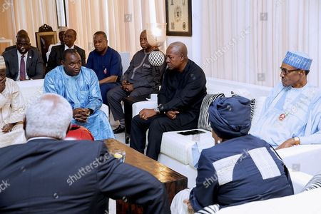 A Photograph Made Available on 14 December 2016 Shows President-elect of Gambia Adama Barrow (l in Blue) Meeting with President of Nigeria Muhammadu Buhari (r) President of Liberia Ellen Johnson Sirleaf (2-r) and Outgoing President of Ghana John Dramani Mahama (3-r) During Talks in Banjul Gambia 13 December 2016 the Talks Come in the Wake of Gambia's President Yahya Jammeh's Refusal to Accept Election Results the High Level Un/au/ecowas Joint Mission on Gambian is Aiming at Seeking a Solution to Resolve the Political Crisis Gambia Banjul