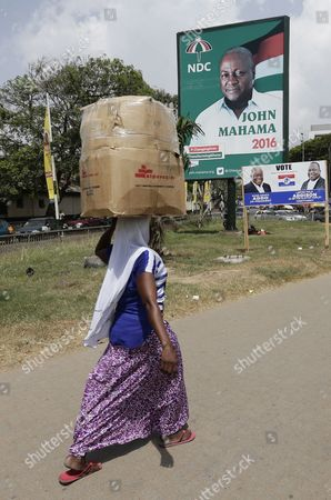 A Ghanaian Woman Walk in Front of a Presidential Campaign Billboard For Incumbent President John Mahama in Accra Ghana 12 November 2016 the General Presidential and Parliamentary Elections in Ghana Will Be Held on 07 December 2016 Ghana Accra