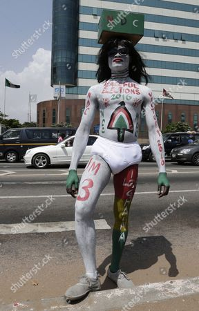 A Supporter of Ghana President and Presidential Candidate John Mahama Poses on a Street in Accra Ghana 12 November 2016 the General Presidential and Parliamentary Elections in Ghana Will Be Held on 07 December 2016 Ghana Accra