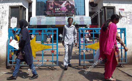 People Walk Past a Theater Screening the Bollywood Movie 'Ae Dil Hai Mushkil' (this Heart is Complicated) on the First Day of Its Release in Mumbai India 28 October 2016 According to Reports After the Attack on an Indian Army Camp in Uri Close to the Line of Control Which Divides Kashmir Between India and Pakistan Raj Thackeray-led Maharashtra Navnirman Sena (mns) Threatened to Stall the Release of the Movie 'Ae Dil Hai Mushkil ' Starring Indian Actors Ranbir Kapoor Anushka Sharma Aishwarya Rai Bachchan and Pakistani Actor Fawad Khan But After the Intervention of the State Government Mns Agreed to Let the Film Release with the Condition That They Don't Hire Any Pakistani Artists in Future India Mumbai