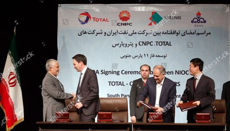 Stock Picture of (l-r) Ali Kardor Managing Director of National Iranian Oil Company (nioc) Stephane Michel President Middle-east & North-africa Total Exploration & Production Hamid Akbari Managing Director of Petroparsgroup and Jean Ping Zhou of China National Petroleum Corporation (cnpc) During Agreement Signed in Tehran Iran 08 November 2016 Iran (islamic Republic Of) Tehran