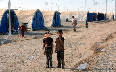 An Iraqi Displaced Boy (l) Wears a Mask Depicting Korean Pop Star Park Jae-sang As He Stands with a Friend at Jadaa Refugees Camp Near Qayyarah City Some 40 Km Southern Mosul Iraq 17 November 2016 According to a Local Official in Jadaa Camp the Camp Which was Opened After the Beginning of the Military Operation to Liberation of Mosul City is Currently Hosting Around Ten Thousand People who Fled From Many Villages Near Mosul Due to the Fighting Between the Iraqi Forces and Islamic State (is) Group Iraq Qayyarah