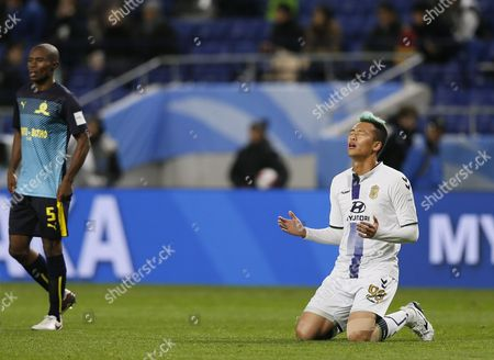 Jeonbuk Hyundai's Forward Kim Shin-wook (r) Celebrates After His Team Defeated Mamelodi Sundowns in the Fifa Club World Cup Japan 2016 Match For 5th Place in Suita Osaka Prefecture Western Japan 14 December 2016 Mamelodi Sundowns' Defender Asavela Mbekile is Seen on the Left Japan Suita