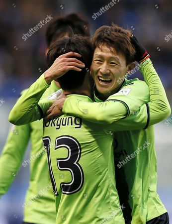 Jeonbuk Hyundai's Midfielder Kim Bo-kyung (l) is Celebrated by Midfielder Lee Jae-sung After Scoring the First Goal During the Fifa Club World Cup Japan 2016 Second Round Match Against Club America at Suita City Football Stadium in Suita Western Japan 11 December 2016 Japan Suita