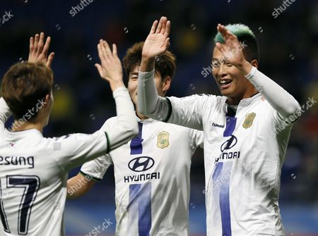 Jeonbuk Hyundai's Forward Kim Shin-wook (r) Celebrates with Teammates After Scoring the Fourth Goal Against Mamelodi Sundowns During the Fifa Club World Cup Japan 2016 Match For 5th Place in Suita Osaka Prefecture Western Japan 14 December 2016 Japan Suita