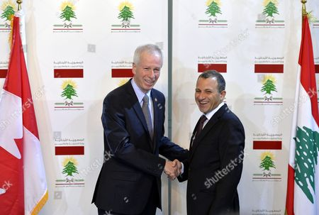 Stock Photo of Canadaian Foreign Minister Stephane Dion (l) Shakes Hands with His Lebanese Counterpart Gebran Bassil (r) at a Joint News Conference After Their Meeting at the Foreign Ministry in Beirut Lebanon 05 December 2016 Dion is on an Official Visit to Meet with Lebanese Officials Lebanon Beirut