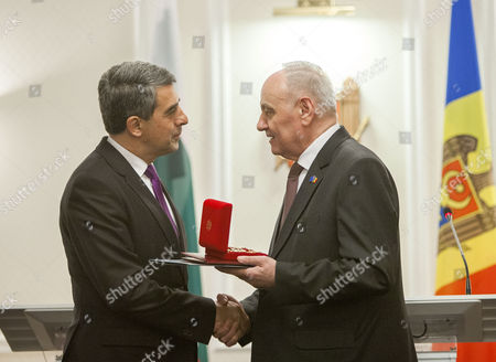 The President of Bulgaria Rosen Plevneliev (l) is Awarded with the 'Order of the Republic' by President of Moldova Nicolae Timofti (r) During His Official Visit at the State Residence in Chisinau Moldova 15 November 2016 Moldova, Republic of Chisinau
