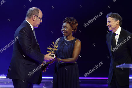Tegla Loroupe of Kenia (c) Receives From Prince Albert Ii of Monaco (l) and Iaaf President Sebastian Coe of Britain (r) Her Trophy For the Presidents Award 2016 During the Iaaf Athletes of the Year Award Ceremony in Monaco 02 December 2016 Loroupe was the Chef De Mission For the Refugee Olympic Team in Rio Monaco Monaco