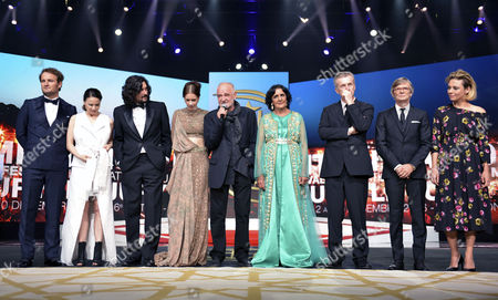 Stock Photo of Members of the Jury (l-r) Australian Actor Jason Clarke Italian Actress Jasmine Trinca Argentine Director Lisandro Alonso Indian Actress Kalki Koechlin Hungarian Director and President of the Jury Bela Tarr Moroccan Actress Fatima Harrandi French Director Bruno Dumont Danish Director Bille August and Canadian Actress Suzanne Clement During the Opening Ceremony of the 16th International Marrakech Film Festival in Marrakesh Morocco 02 December 2016 Morocco Marrakesh