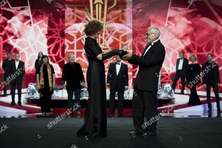 Russian Movie Director and President of the Russian Delegation Karen Shakhnazarov (r) is Presented with a Trophy From French Actress Fanny Ardant (l) As Tribute to Russian Cinema During the 16th Annual Marrakech International Film Festival (fifm) in Marrakech Morocco 07 December 2016 the Festival Runs From 02 to 10 December Morocco Marrakech