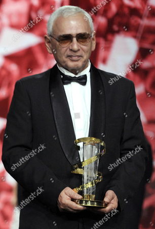 Russian Movie Director and President of the Russian Delegation Karen Shakhnazarov (r) Poses After Receiving a Trophy As Tribute to Russian Cinema During the 16th Annual Marrakech International Film Festival (fifm) in Marrakech Morocco 07 December 2016 the Festival Runs From 02 to 10 December Morocco Marrakech