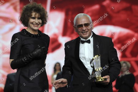 Russian Movie Director and President of the Russian Delegation Karen Shakhnazarov (r) Receives a Trophy From French Actress Fanny Ardant (l) As Tribute to Russian Cinema During the 16th Annual Marrakech International Film Festival (fifm) in Marrakech Morocco 07 December 2016 the Festival Runs From 02 to 10 December Morocco Marrakech