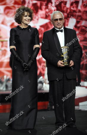 Russian Movie Director and President of the Russian Delegation Karen Shakhnazarov (r) After Receiving a Trophy From French Actress Fanny Ardant (l) As Tribute to Russian Cinema During the 16th Annual Marrakech International Film Festival (fifm) in Marrakech Morocco 07 December 2016 the Festival Runs From 02 to 10 December Morocco Marrakech