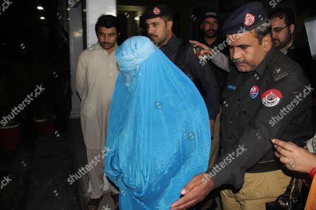 Pakistani Security Officials Escort Afghan Refugee Woman Sharbat Gula (l in Burqa) After She was Deported to Afghanistan in Peshawar Pakistan Early 09 November 2016 Pakistani Anti-corruption and Immigration Court Had on 04 November Has Handed a 15-days Jail and 110000 Pak Rupees (1000 Us Dollar) Fine to Sharbat Gula Before Being Deported to Afghanistan Gula Has Been Detained For Allegedly Possessing a Fake Identity Card She was Arrested on 26 October For Allegedly Obtaining Pakistani Identity Documents For Herself and Her Two Children After Bribing Three Officials Charges That Could Land Her a 14-year Jail Sentence Sharbat Gula Became Famous by the Photographic Portrait 'Afghan Girl' Taken of Her with Her Striking Green Eyes by Photographer Steve Mccurry and Published on the Cover of the 'National Geographic' in June 1985 Pakistan Peshawar