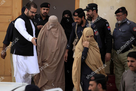 Pakistani Security Officials Escort Afghan Refugee Woman Sharbat Gula (c in Burqa) After a Court Hearing in Peshawar Pakistan 04 November 2016 Pakistani Anti-corruption and Immigration Court on 04 November Has Awarded 15 Days Jail and 110000 Pak Rupees (1000 Us Dollar) Fine to Sharbat Gula Before Being Deported to Afghanistan Gula Has Been Detained For Allegedly Possessing a Fake Identity Card She was Arrested on 26 October For Allegedly Obtaining Pakistani Identity Documents For Herself and Her Two Children After Bribing Three Officials Charges That Could Land Her a 14-year Jail Sentence Sharbat Gula Became Famous by the Photographic Portrait 'Afghan Girl' Taken of Her with Her Striking Green Eyes by Photographer Steve Mccurry and Published on the Cover of the 'National Geographic' in June 1985 Pakistan Peshawar