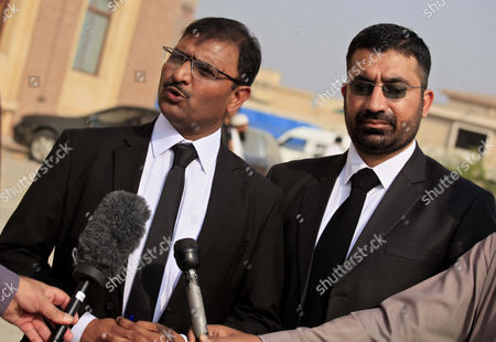 Malik Mubashir Nazar (l) a Lawyer of Afghan Refugee Woman Sharbat Gula Talks with Journalists After a Court Hearing in Peshawar Pakistan 04 November 2016 Pakistani Anti-corruption and Immigration Court on 04 November Has Awarded 15 Days Jail and 110000 Pak Rupees (1000 Us Dollar) Fine to Sharbat Gula Before Being Deported to Afghanistan Gula Has Been Detained For Allegedly Possessing a Fake Identity Card She was Arrested on 26 October For Allegedly Obtaining Pakistani Identity Documents For Herself and Her Two Children After Bribing Three Officials Charges That Could Land Her a 14-year Jail Sentence Sharbat Gula Became Famous by the Photographic Portrait 'Afghan Girl' Taken of Her with Her Striking Green Eyes by Photographer Steve Mccurry and Published on the Cover of the 'National Geographic' in June 1985 Pakistan Peshawar