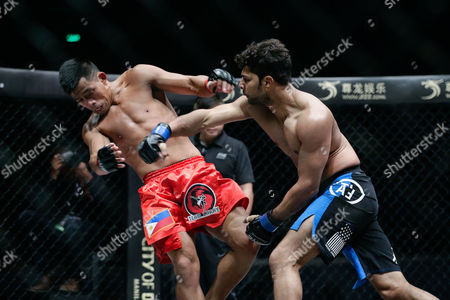 Rajinder Singh Meena of India (r) in Action Against Honorio Banario of the Philippines (l) During Their Lightweight Mixed Martial Arts (mma) One Championship Bout in Pasay City South of Manila Philippines 02 December 2016 Philippines Manila