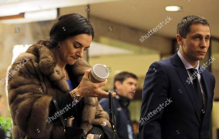 Former Russian Pole Vaulter Yelena Isinbayeva (l) and Russian Track and Field National Team Coach Yuriy Borzakovskiy (r) Leave After All-russia Athletic Federation (araf) President Dmitry Shliakhtin Has Been Re-elected For Another Term During a Araf Election Conference in Moscow Russia 09 December 2016 Russian Federation Moscow