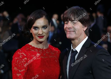 Germany's National Soccer Team Coach Joachim Loew (r) and Former Russian Pole Vaulter Yelena Isinbayeva Arrive For the Draw of the Fifa Confederations Cup 2017 in Kazan Russia 26 November 2016 Russian Federation Kazan