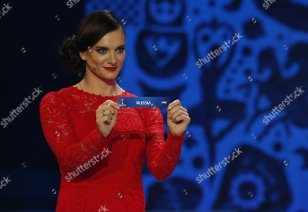 Former Russian Pole Vaulter Yelena Isinbayeva Shows the Ticket of Russia During the Draw of the Fifa Confederations Cup 2017 in Kazan Russia 26 November 2016 Russian Federation Kazan