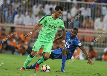 Al-ahli Player Omar Al-somah (l) in Action For the Ball with Al-hilal Player Osama Hawsawi (r) During the Saudi Professional League Soccer Match Between Al-ahli and Al-hilal at King Abdullah Al Jawhara International Stadium in Jeddah Saudi Arabia 25 November 2016 Saudi Arabia Jeddah