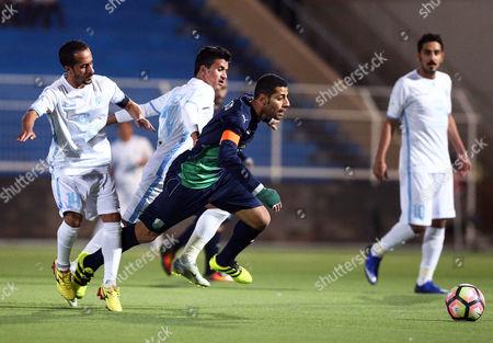 Al-ahli's Taisir Al-jassim (c) in Action Against Al-batin's Waleed Hizam (l) During the Saudi Professional League Soccer Match Between Al-batin Fc and Al-ahli S Fc at Al-batin Club Stadium in Hafar Al-batin Saudi Arabia 20 November 2016 Saudi Arabia Hafar Al-batin