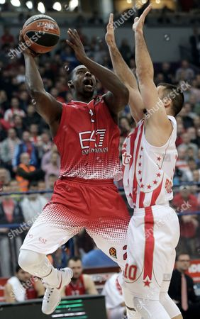 Branko Lazic (r) of Red Star in Action Against Rakim Sanders (l) of Ea7 Emporio Armani Milan During the Euroleague Basketball Match Between Red Star and Ea7 Emporio Armani Milan in Belgrade Serbia 17 November 2016 Serbia and Montenegro Belgrade