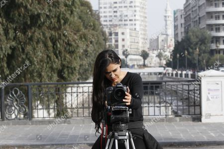 Stock Picture of Bolivian Actress Carla Ortiz Checks a Camera During the Shooting of a New Documentary Damascus Syria 04 December 2016 Ortiz is Reportedly Directing and Producing a Second Documentary in Damascus Ortiz Visited Damascus in May Too Syrian Arab Republic Damascus