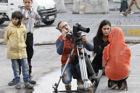 Stock Photo of Bolivian Actress Carla Ortiz (r) Talks with a Child a Cast Member of Her New Documentary During a Visit in Damascus For Filming a Documentary Damascus Syria 04 December 2016 Ortiz is Reportedly Directing and Producing a Second Documentary in Damascus Ortiz Visited Damascus in May Too Syrian Arab Republic Damascus