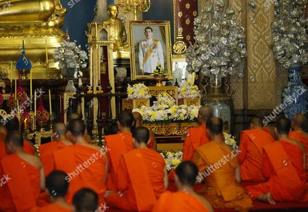 Thai Buddhist Monks Gather For a Prayer Ceremony on the Occasion of the Accession of King Rama X to the Throne in Front of a Portrait of the New King Maha Vajiralongkorn Bodindradebayavarangkun (c) at Wat Benchamabophit Dusitvanaram Also Known As the Marble Temple in Bangkok Thailand 01 December 2016 Thailand Has New King After Crown Prince Maha Vajiralongkorn 64 Accepted to Ascend the Throne to Become the Country's New Monarch the 10th King of the 234-year-old Chakri Dynasty the King Maha Vajiralongkorn Bodindradebayavarangkun Succeeds His Late Father Thai King Bhumibol Adulyadej the World's Longest Reigning Monarch who Died at the Age of 88 in Siriraj Hospital on 13 October 2016 Thailand Bangkok