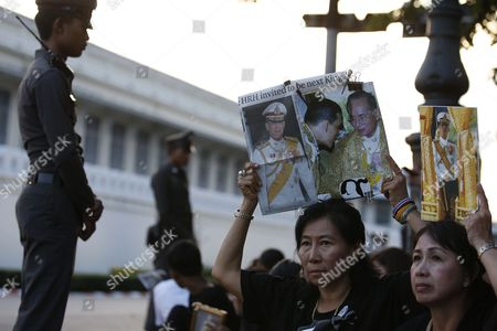 Thai Well-wishers Hold Up Portraits of Thai Crown Prince Maha Vajiralongkorn and His Father Late Thai King Bhumibol Adulyadej (c) As They Gather Outside the Grand Palace in Bangkok Thailand 01 December 2016 the Buddhist Monks of All Thai Temples in the World Will Pray For the Crown Prince Maha Vajiralongkorn 64 Ascending the Throne As the 10th King of the Chakri Dynasty by the Formally Invitation of Thailand's National Legislative Assembly (nla) and the Heads of Country Executive on 01 December 2016 the Prince is Due to Succeed His Father Late Thai King Bhumibol Adulyadej the World's Longest Reigning Monarch who Died at the Age of 88 in Siriraj Hospital on 13 October 2016 Thailand Bangkok