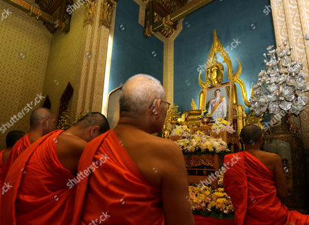 Thai Buddhist Monks Gather in Front of a Buddha Statue For a Prayer Ceremony on the Occasion of the Accession of King Rama X to the Throne at Wat Benchamabophit Dusitvanaram Also Known As the Marble Temple in Bangkok Thailand 01 December 2016 Thailand Has New King After Crown Prince Maha Vajiralongkorn 64 Accepted to Ascend the Throne to Become the Country's New Monarch the 10th King of the 234-year-old Chakri Dynasty the King Maha Vajiralongkorn Bodindradebayavarangkun Succeeds His Late Father Thai King Bhumibol Adulyadej the World's Longest Reigning Monarch who Died at the Age of 88 in Siriraj Hospital on 13 October 2016 Thailand Bangkok