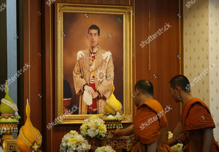 Thai Buddhist Monks Prepare For a Prayer Ceremony in Front of a Portrait of Thai Crown Prince Maha Vajiralongkorn on the Occasion of the Historic Moment of the Accession of New Thai King Rama X to the Throne at the Wat Yannawa Temple in Bangkok Thailand 01 December 2016 the Buddhist Monks of All Thai Temples in the World Will Pray For the Crown Prince Maha Vajiralongkorn 64 Ascending the Throne As the 10th King of the Chakri Dynasty by the Formally Invitation of Thailand's National Legislative Assembly (nla) and the Heads of Country Executive on 01 December 2016 the Prince is Due to Succeed His Father Late Thai King Bhumibol Adulyadej the World's Longest Reigning Monarch who Died at the Age of 88 in Siriraj Hospital on 13 October 2016 Thailand Bangkok