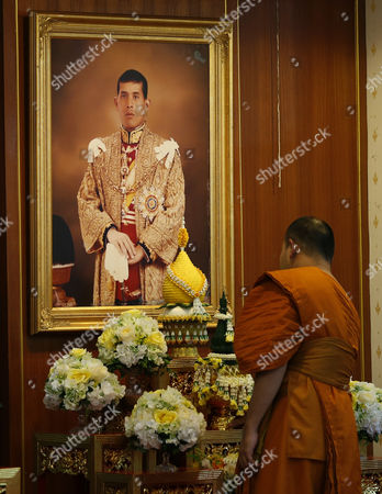 Stock Picture of A Thai Buddhist Monk Prepares For a Prayer Ceremony in Front of a Portrait of Thai Crown Prince Maha Vajiralongkorn on the Occasion of the Historic Moment of the Accession of New Thai King Rama X to the Throne at the Wat Yannawa Temple in Bangkok Thailand 01 December 2016 the Buddhist Monks of All Thai Temples in the World Will Pray For the Crown Prince Maha Vajiralongkorn 64 Ascending the Throne As the 10th King of the Chakri Dynasty by the Formally Invitation of Thailand's National Legislative Assembly (nla) and the Heads of Country Executive on 01 December 2016 the Prince is Due to Succeed His Father Late Thai King Bhumibol Adulyadej the World's Longest Reigning Monarch who Died at the Age of 88 in Siriraj Hospital on 13 October 2016 Thailand Bangkok