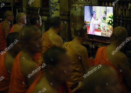 Thai Buddhist Monks Watch the Television Broadcast of the Accession to the Throne Proclamation Ceremony of the New King Maha Vajiralongkorn Bodindradebayavarangkun As They Gather For a Prayer Ceremony on the Occasion at Wat Benchamabophit Dusitvanaram Also Known As the Marble Temple in Bangkok Thailand 01 December 2016 Thailand Has New King After Crown Prince Maha Vajiralongkorn 64 Accepted to Ascend the Throne to Become the Country's New Monarch the 10th King of the 234-year-old Chakri Dynasty the King Maha Vajiralongkorn Bodindradebayavarangkun Succeeds His Late Father Thai King Bhumibol Adulyadej the World's Longest Reigning Monarch who Died at the Age of 88 in Siriraj Hospital on 13 October 2016 Thailand Bangkok